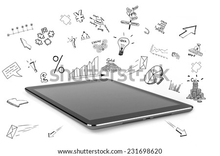 Tablet and business drawings - stock photo