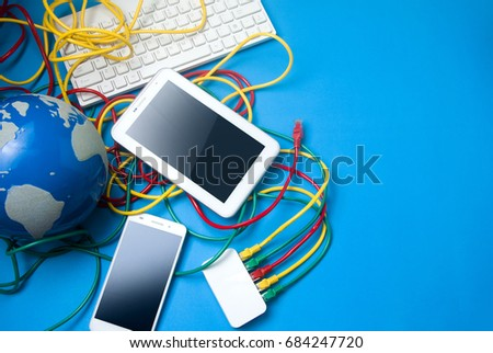 Tablet mobile phone lan wire router stock photo royalty free tablet and mobile phone with lan wire and router connect to global world network with white greentooth Images