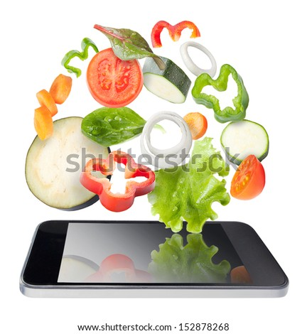 Tablet and vegetables isolated. Recipes application concept. Vegetables and tablet, isolated. Recipes application concept.   - stock photo