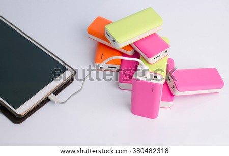 Tablet charging with Power bank Battery - stock photo