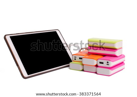 Tablet charging with Power bank Battery Isolated on white background - stock photo