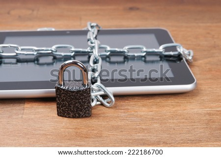 Tablet computer and chain with a lock, the protection of personal information