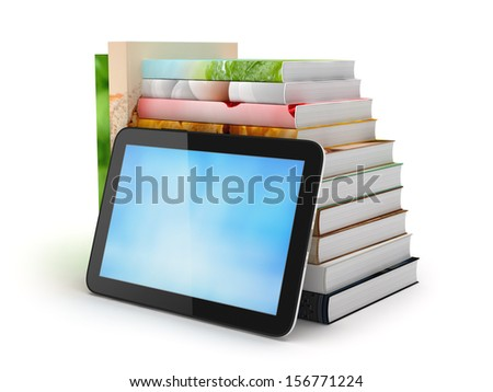 Tablet computer and stack of books - stock photo