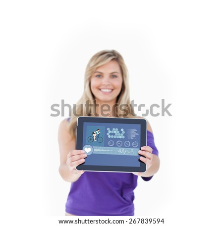 Tablet computer being held by a blonde woman against fitness interface - stock photo