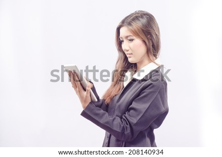 Tablet computer. Business woman using digital tablet computer PC happy isolated on white background. Beautiful mixed race Asian / Caucasian woman in business shirt with finger on touch screen display. - stock photo
