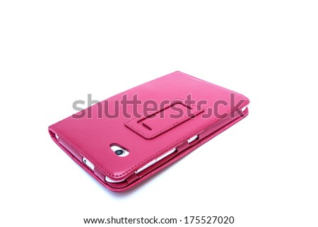 Tablet computer in pink case isolated on white background - stock photo