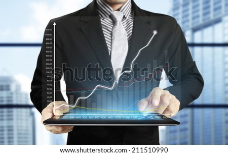 tablet computer isolated in a hand on,show graph - stock photo