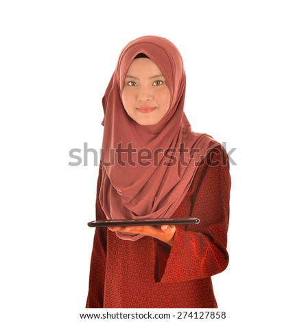 Tablet computer. Muslimah woman using digital tablet isolated on white background.  - stock photo