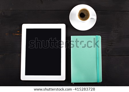 tablet computer, notebook, mobile phone and coffee cup