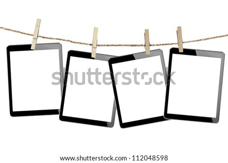 tablet computer pc in Wood clamps on white background + Clipping Path