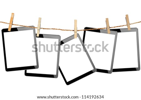 tablet computer pc with isolated screen in Wood clamps on white background - stock photo