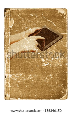 Tablet computer, smartphone in girl hands on cover of old book