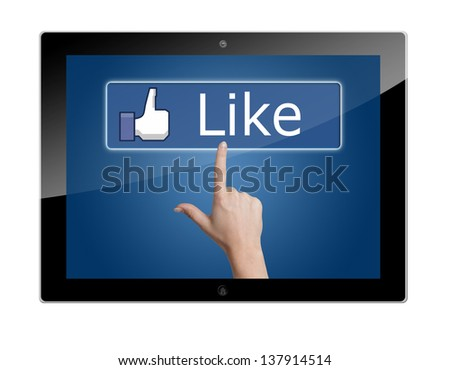 Tablet Computer with a social media like button - stock photo