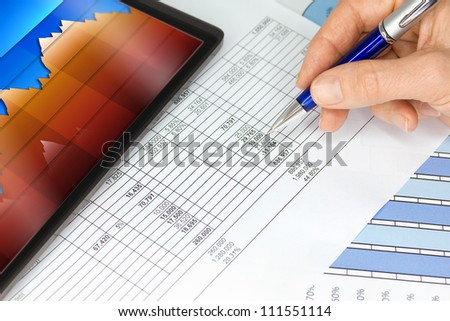 Tablet Computer with Hand Pen Figures Blue Orange Graphs - stock photo