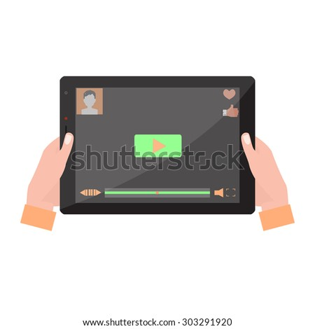 Tablet computer with video player on the screen in the human hands. - stock photo
