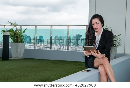 Tablet computer. Woman using digital tablet computer PC happy isolated on white background. Focus on both tablet and face. Beautiful  / Caucasian woman in business shirt. - stock photo
