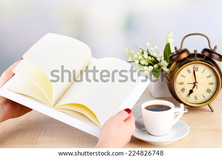 Tablet, cup of coffee and alarm clock, close up - stock photo