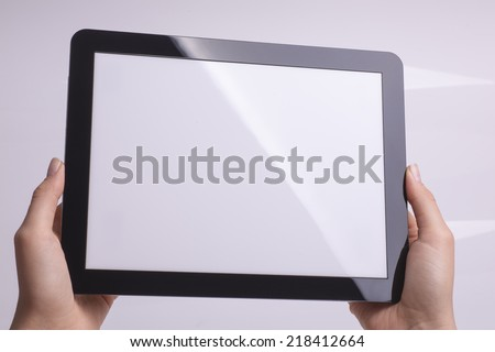 Tablet holding in hand - stock photo