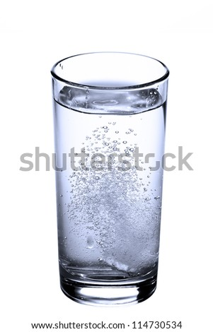 tablet in glass of water isolated on white - stock photo