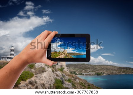Tablet in hand photo shooting Mediterranean coast - these are all photos made by me, that you separately can find on my shutterstock portfolio. - stock photo