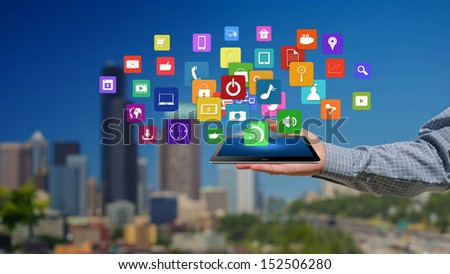 Tablet in hands with colorful icons,Creative Business  - stock photo