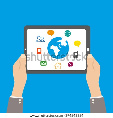 Tablet in hands with social media icons
