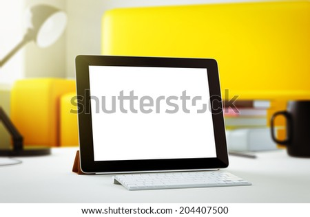 Tablet in room - stock photo
