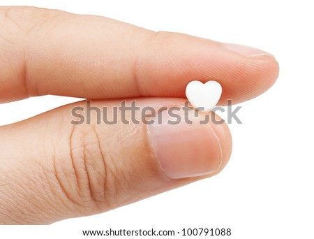tablet in the fingers isolated on a white background - stock photo