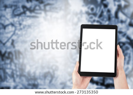Hipster person holding hands digital tablet stock photo 605331515 tablet in the hands of women and graffiti in the background voltagebd Images