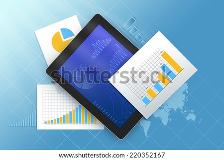 Tablet is surrounded by sheets with charts