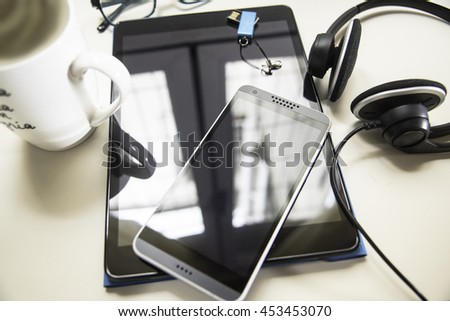 tablet, laptop and cellphone connecting wifi / Tablet y teléfono móvil - stock photo