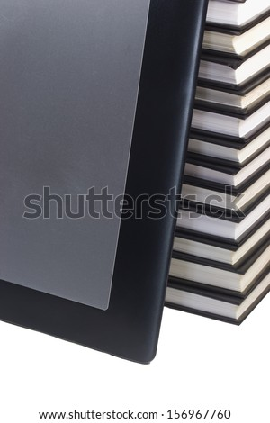 Tablet leaning on books. White background. - stock photo