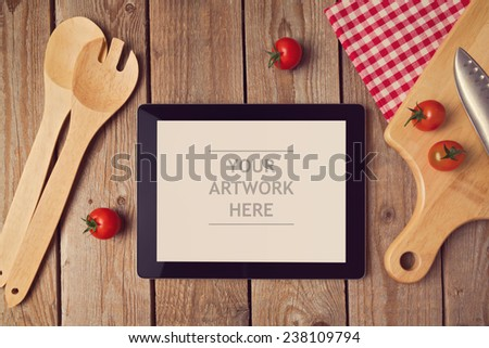 Tablet mock up template with cooking utensil. View from above - stock photo