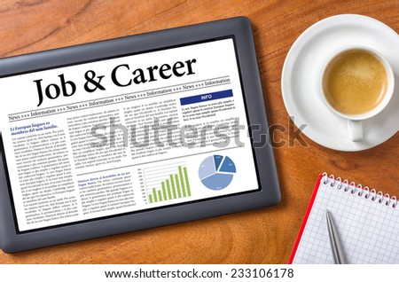 Tablet on a desk - Job and Career - stock photo