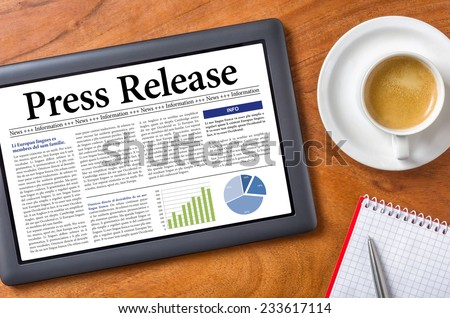 Tablet on a desk - Press Release - stock photo