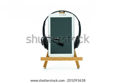 Tablet on a wooden platform on a white background. - stock photo