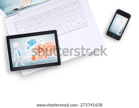 Tablet on laptop and mobile phone near on isolated white background, top view. Closed up - stock photo