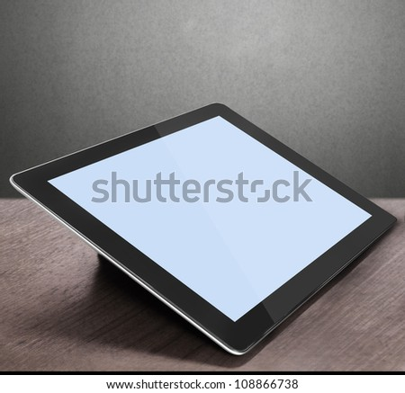 tablet on the table wooden - stock photo