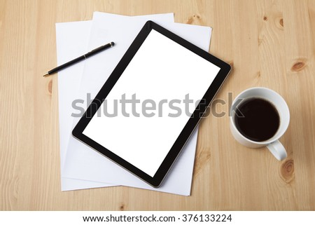 Tablet on wooden table