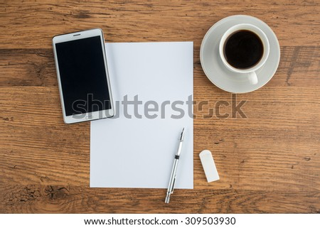 Tablet, paper, Eraser and Mechanical pencil with cup of  coffee