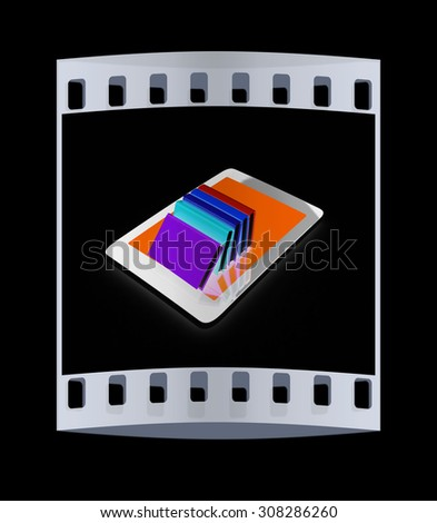 tablet pc and colorful real books on black background. The film strip - stock photo