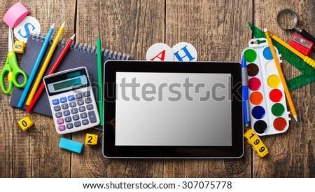 Tablet pc and different schoolchild and student studies accessories. Back to school concept. - stock photo