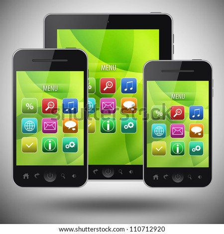Tablet pc and mobile phone on gray background