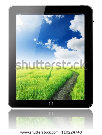 tablet pc computer modern technology touch for the future background black model with green grass blue sky background for recycle and eco technology on white background for design - stock photo