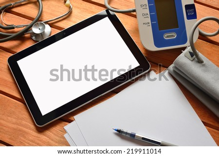 Tablet pc computer with stethoscope and automatic blood pressure  - stock photo