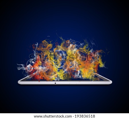 Tablet pc emits colored smoke. The technology concept