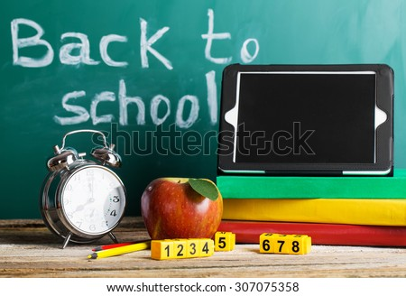 Tablet pc, Globe, notebook stack and pencils. Schoolchild and student studies accessories. Back to school concept. - stock photo