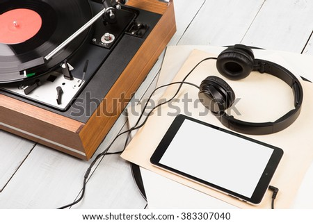 Tablet pc, headphones and turntable - stock photo