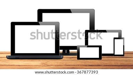 Tablet pc, mobile phone and computer on table isolated on white background