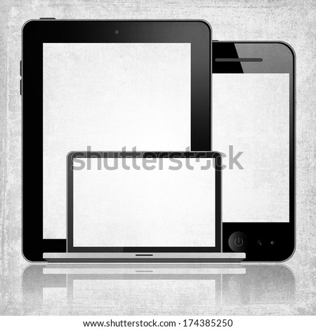Tablet pc, mobile phone and notebook - stock photo